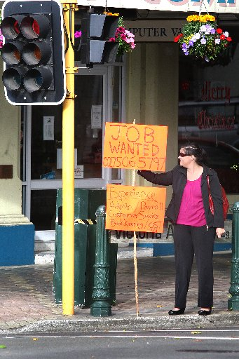 JOB WANTED: Sharla May standing on Victoria Ave hoping her sign does not blow away as she finds work. PHOTO: BEVAN CONLEY