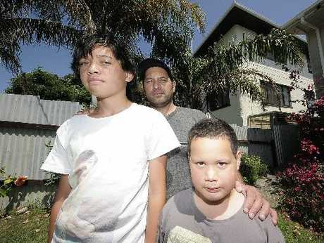 HELP: Rangi Taueki and his sons Brieley (left) and Brayten called the fire brigade when they noticed their neighbour's house was on fire yesterday.