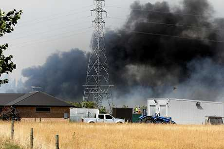 Black smoke fills the sky as multiple fires spread south of Christchurch, in the Selwyn Rd, Robinsons Rd area