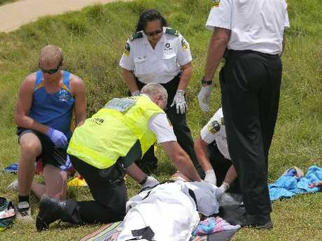DUNE MISHAP: An injured man is tended by Northland Electricity rescue helicopter staff, and is carried to the waiting chopper.