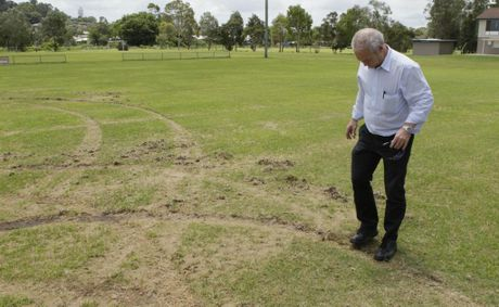 Lismore Thistles Soccer Club president Paul Albertini inspects the damage done by vandals last year after they had just invested thousands of dollars in repairing their fields. The fields were damaged again by hoons last night. Photo Jay Cronan / The Northern Star