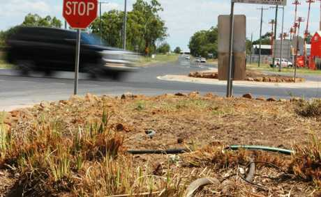 CALL FOR ACTION: A makeover has been started on the garden beds at the Carmichael St-Warrego Highway intersection.