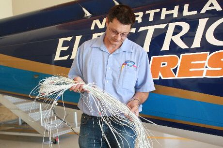 MEAN THEFT: Dean Voelkerling with wire like that stolen from the Onerahi airport hangar on January 6.
