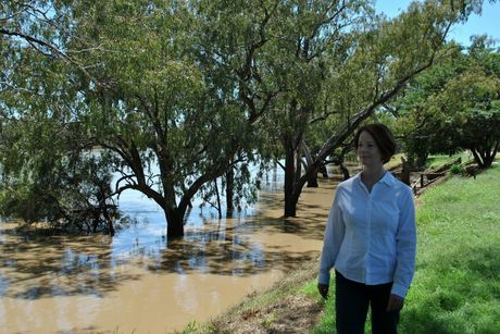 OUT OF THE SPOTLIGHT: Prime Minister Julia Gillard surveys the swollen Balonne River last year. Several local flood victims have suggested a mitigation response is moving too slowly now the Balonne Shire is out of the national spotlight.