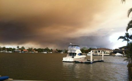 Meghan Bell captures the smoke looming over Banksia Beach on Thursday.
