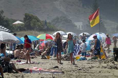 PLENTY OF SUN: Thousands of people crowded Waimarama beach in search of a cooling swim. HBT130372-08