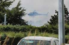 A helicopter can be seen through smoke from a scrub fire in Shands Road in the Prebbleton area of Christchurch