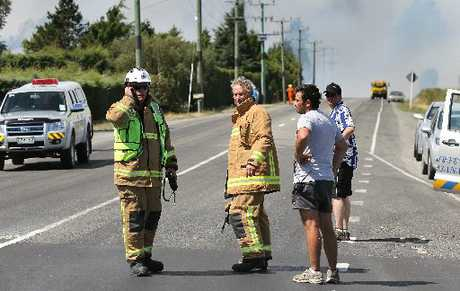 Fire crews struggle to take charge as the blaze burns out of control at the intersection of Selwyn Rd and Robinsons Rd.
