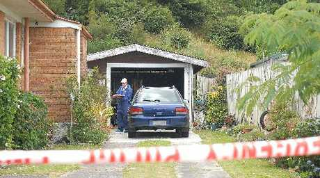 SEARCH: Forensic staff at the Holyoake Cres address in Kawerau where a man was fatally stabbed.