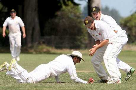 GOTCHA: Taranaki captain Dion Ebrahim pulls off a brilliant catch to dismiss Kane Watkin yesterday afternoon.