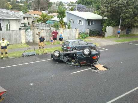 A woman was taken to hospital after the car she was driving rolled and landed on its roof.