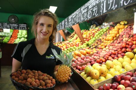 Buderim Fruit and Veg employee Kelly Ade has proved excellent in customer service after the business was awarded Brisbane Produce Market Retailer of the Month for December 2012 Photo Emily Haynes / Buderim Chronicle