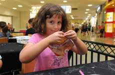 WIDE BAY KIDS: Teagan Smith works on her butterfly creation at the school holidays activities at Hinkler Central.