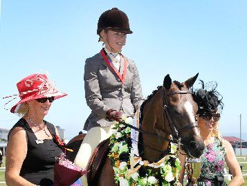 EPITOME OF ELEGANCE: Jorjia Weck on Aschbrooke Bracken, who won the Show Circuit National Supreme Champion Saddle Hunter Pony up to 138cm, is flanked by judges Marg Hendy (left) and Trina Crawford (right).