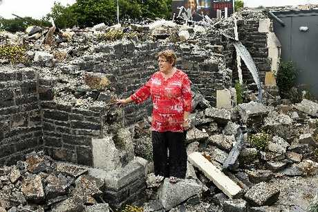 SHATTERED: Dorothy Haywood stands in the ruins of the Sydenham Heritage Church.