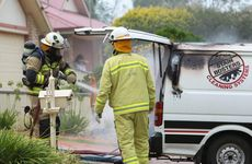 Firefighters work to extingusih a cleaning van that caught fire in Spring St yesterday.