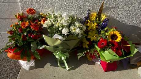 Flowers pictured outside the house in Waihi Beach where Robert Wilkinson was stabbed.