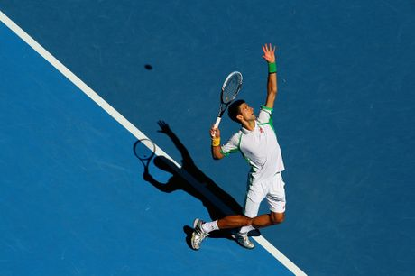 Novak Djokovic of Serbia serves in his first round match against Paul-Henri Mathieu of France during day one of the 2013 Australian Open at Melbourne Park on January 14, 2013 in Melbourne, Australia.