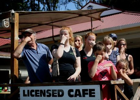 TOO MUCH: Cove Cafe co-owner Bob Hirst, left, with staff and patrons who are sick of the pong.