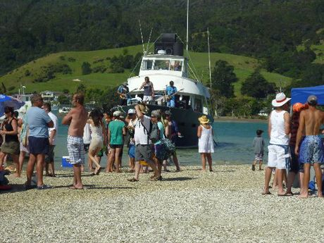 WATER MUSIC: The crowd was entertained by Whangarei band Stone Blue from the front of a launch at the McLeod Bay Sand Bank Party on Saturday.