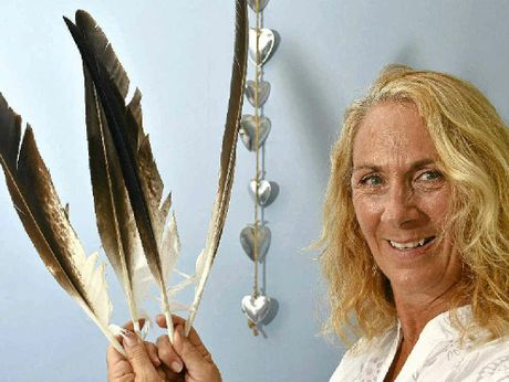 Psychic Jannine Umana says feather spirit readings have won over the wary.