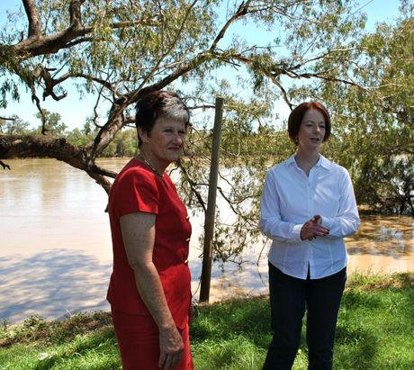 "FLOOD FACTS: Balonne Shire Council mayor Donna Stewart, pictured inspecting the swollen Balonne River with Prime Minister Julia Gillard in 2012, says the council has to get the facts about a permanent levee ""on paper"" before information can be released"
