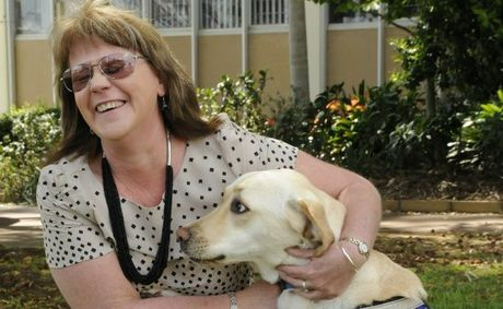 Janet Etchells with her seeing eye dog Fergie. Janet will set off in June for a 10-day hike along the Great Wall of China.