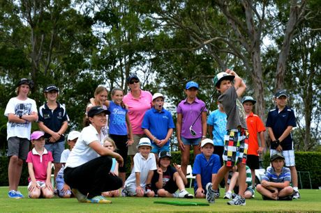 Rachel Hetherington works with 9 yo Jimmy Bourne at the kids golf clinic at Rachel Hetherington driving range. Photo: John Gass / Daily News