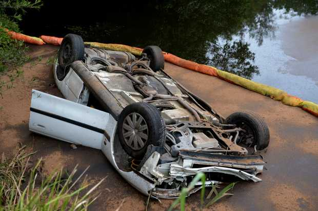 Car sitting at the bottom of a four-metre drop in the Tweed river.