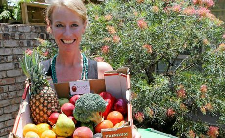 DO THE RIGHT BIN: Ballina Shire Council's communication and education officer – waste, Kate Pye, with a hamper you could win by putting the right things in your organics bin.