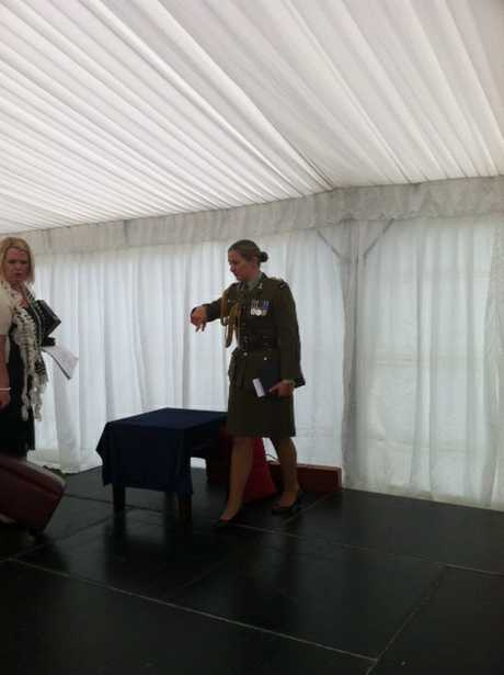 Media are taken into the marquee to set up for the investiture ceremony.  PHOTO/PAUL TAYLOR