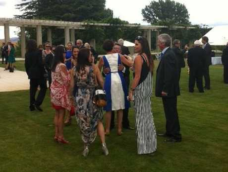 Sir Paul hugs guests with daughter Millie in foreground in a striped maxi dress. PHOTO/PAUL TAYLOR