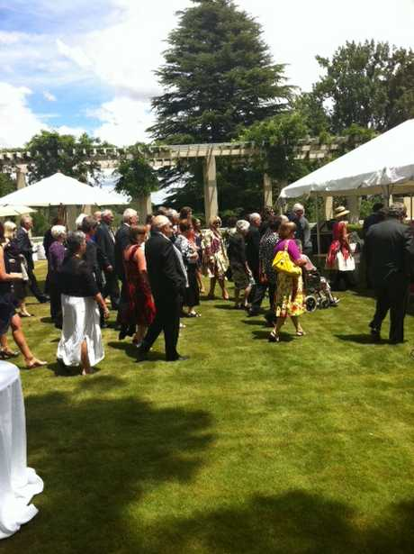 Guests moves toward the marquee to be seated for the investiture ceremony.  PHOTO/PAUL TAYLOR.