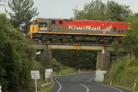 The last freight train travelling from Wairoa to Napier ran in early November 2012,spotted here on an overbridge just north of Lake Tutira. PHOTO/WARREN BUCKLAND HBT124328-2
