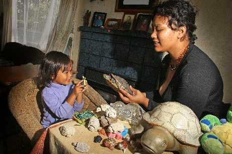 THAT ONE MOVES: Jess Kahukura and her daughter Emmy-Jay show off turtle collection and pet Lillyana.