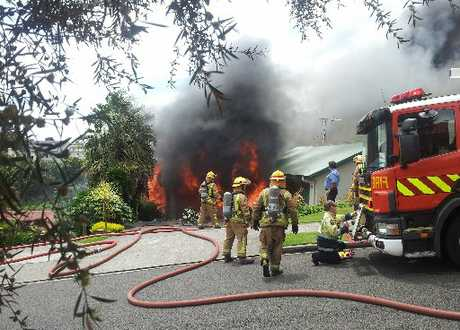 FIGHTING FLAMES: Firefighters battle the blaze at a home in Te Koari Drive, Brookfield, yesterday.