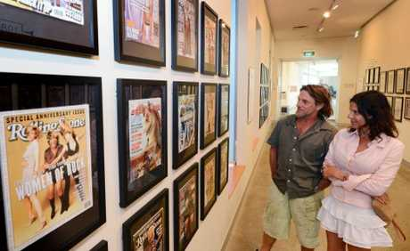 Basilia Bensoussan and Dayan Dennis from Byron Bay check out the Rolling Stone exhibition at Tweed Regional Art Gallery. Photo: Blainey Woodham / Daily News