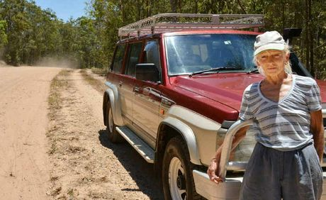Liz Williams and her long suffering vehicle on the much-pitted arterial road past her street at Anderleigh.