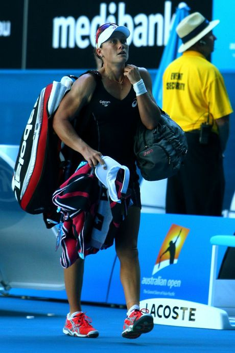 Sam Stosur of Australia walks off court after losing her second round match against Jie Zheng of China during day three of the 2013 Australian Open at Melbourne Park on January 16, 2013 in Melbourne, Australia.