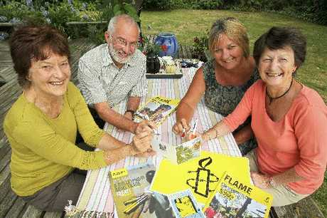 SIGNED OFF: Signing the goodwill card for Kartam Joga are Beth Allardice (left), Tony Johnson, Deb Richardson and organiser Louisa Palairet. PHOTO/WARREN BUCKLAND HBT130403-2