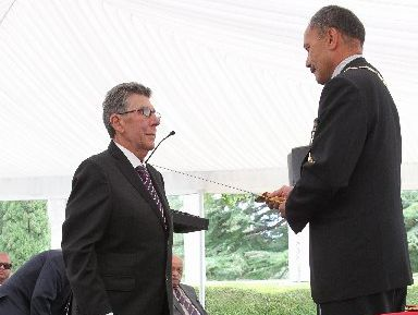 MEDAL MAN: Sir Paul Holmes was knighted (left) during an emotional ceremony at his Poukawa estate, Mana Lodge by Governor General Sir Jerry Mateparae. PHOTO/WARREN BUCKLAND HBT130439-26