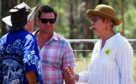 Byron Shire mayor Simon Richardson and Lismore City mayor Jenny Dowell talk to protesters at the Glenugie CSG blockade. Photo Frank Falkenstein.