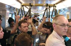 Not one of the 50 Sunshine Coast-bound passengers on the 5pm train from Roma Street to Nambour seems happy as they head home yesterday. The Daily's Kathy Sundstrom took the commuter trip there and back, and found frustration and anger.