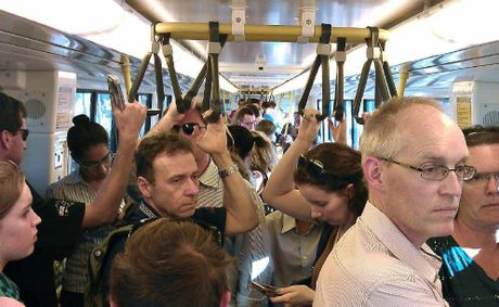 Not one of the 50 Sunshine Coast-bound passengers on the 5pm train from Roma Street to Nambour seems happy as they head home.