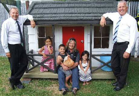 Lil Tulloch (centre) recently won the G J Gardner Wendy house raffle, which raised $4700 for the BayTrust Rescue Helicopter. Pictured are (from left) G J Gardner Rotorua franchise owner Graham Fuller, Mrs Tulloch&#39;s grandchildren Michaela Creighton, 4, Liam Creighton, 3, Bileigh Creighton, 3, and G J Gardner Rotorua sales consultant Trevor Newbrook.