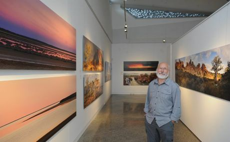 Photographer Richard Green at his exhibition Remote &amp; Wild which is on show at the art gallery in Pialba.