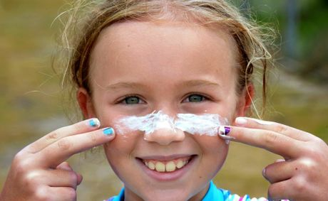 Sun smart kid: Natasha Silabon, 9, puts on some sunscreen.