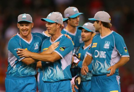 The Heat celebrate after defeating the Renegades during the Big Bash League Semi-Final match between the Melbourne Renegades and the Brisbane Heat at Etihad Stadium on January 15, 2013 in Melbourne, Australia.