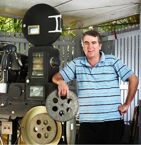 PICTURE SHOW MAN: Chris Hampton enjoys old theatre and he has lots of memorabilia including this projector and reel.