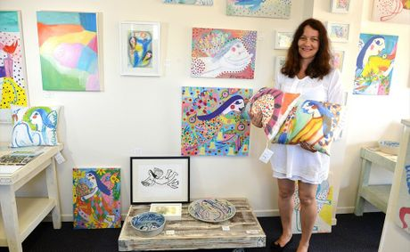 Nadine Sawyer shows off some of her work at her Moffat Beach pop-up shop.